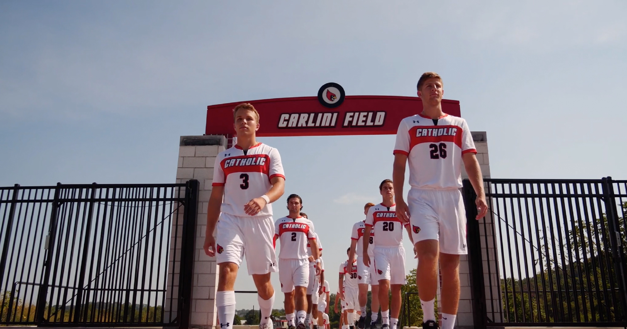 Men's soccer team entering Carlini Field