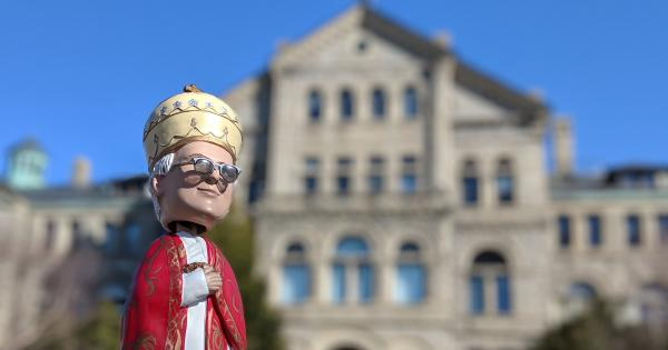 Bobblehead of Pope Leo XIII in front of McMahon Hall