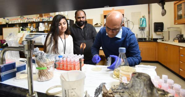 Dr. Rao in a biology lab with students