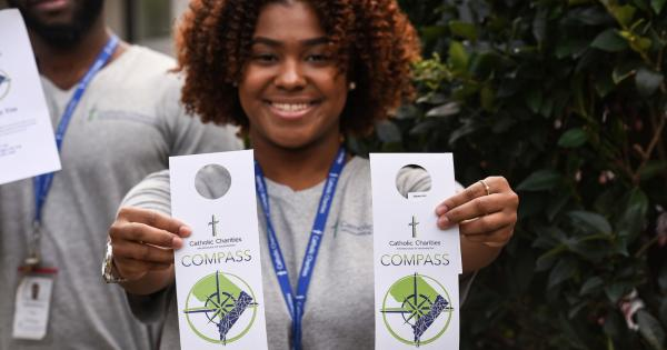 NCSSS student with Compass program flyer