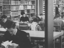 Archival photo of people studying in Mullen Library