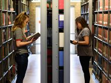 Students in the Mullen Library stacks